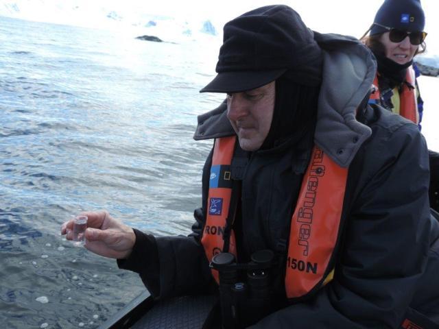 Photo credit: Pat Briody.  Guest Jim Briody participating in water sampling.
