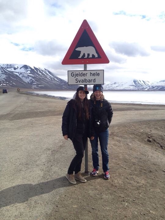 Polar bear road sign with Merinda, Grosvenor Teacher Fellow from Utah